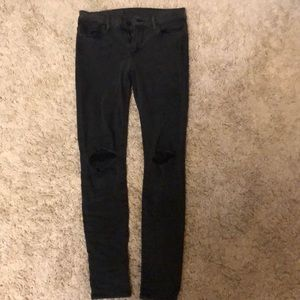 Joes jeans black skinny jeans with knee rips.